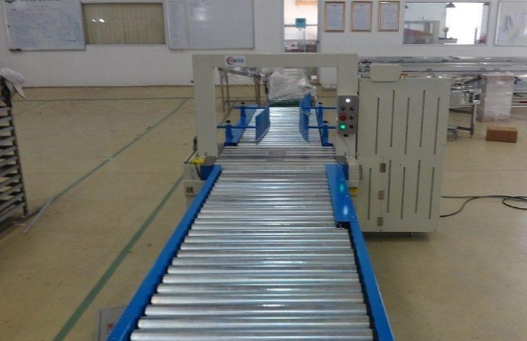 cấu tạo băng tải con lăn kết hợp máy đóng đai